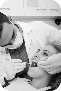 emergency dentist working on someone's teeth